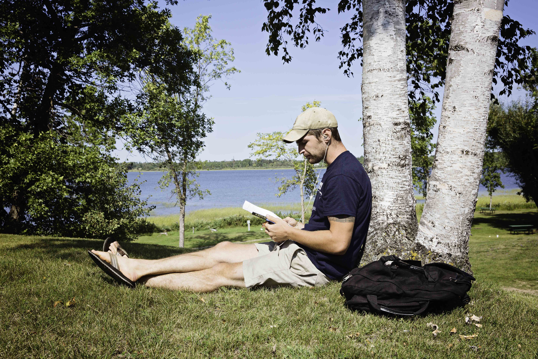 Steve_Daniels_under_tree_reading.jpg